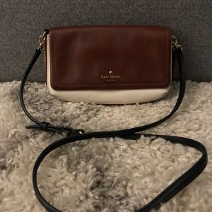 Brown and white Kate Spade crossbody purse